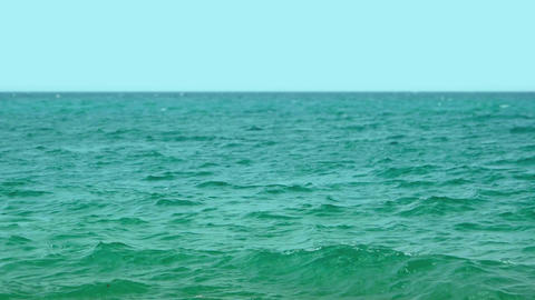 Peaceful Tropical Seascape under a Bold. blue Horizon. Video FullHD Live Action