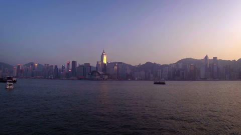 Hong Kong's iconic Skyline from Victoria Harbour. Video FullHD Live Action