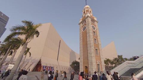 Tsim Sha Tsui clock tower and passenger ferry terminal in Hong Kong Footage