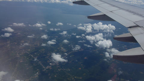 View from the airplane window on the wing and clouds. Travel to other countries Live Action