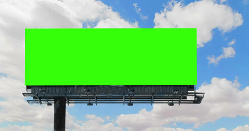empty billboard with chroma key green screen, on blue sky with clouds time-lapse, advertisement Live Action