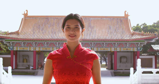 Asian young woman in old traditional Chinese dresses in the Temple Live Action