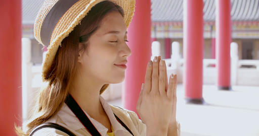tourist young woman praying at chinese temple Stock Video Footage