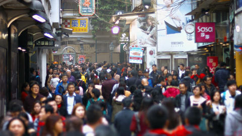 Dense pedestrian traffic in Macau's crowded. downtown district. with sound Live Action