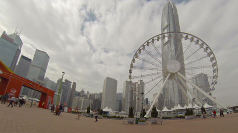 Ferris Wheel with Hong kong International Finance Centre on background Footage