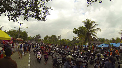 Overcrowded motorcycle parking outside Taman Ayun Royal Temple in Bali Footage