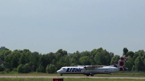 Airplane ATR steering on runway after landing Footage