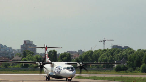 Close-up of small airliner ATR on the strip Footage