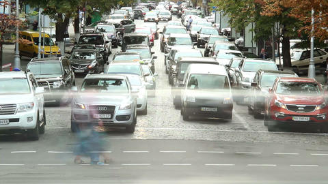 City crossing in rush hour, people mass cross road, cars Footage