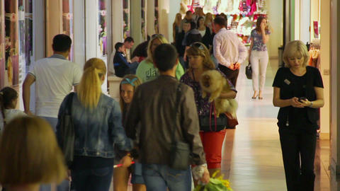 People walking in shopping center, trade center crowd indoors Live Action