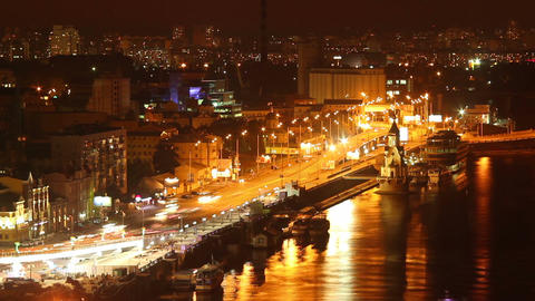 Night city quay cars drive leaving yellow lights urban timelapse Footage