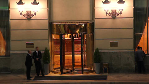 Hotel entrance night time lapse, visitors guests come in out Footage