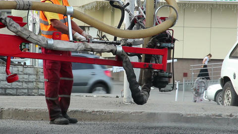 Process of patching city road, machine patches bad road daytime Footage