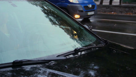 Raining on front car glass, wipers at work, fall, day Footage