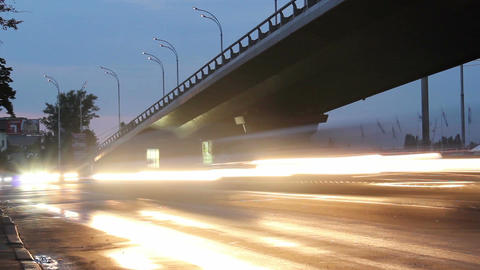 Cars timelapse, city road junction bridge, street light turn on Footage
