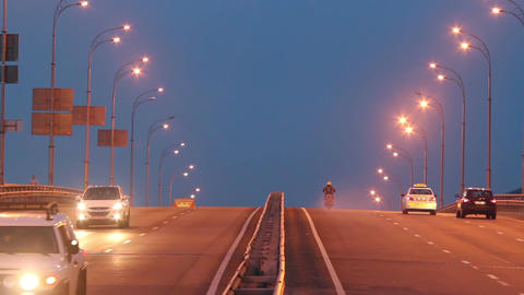 Highway traffic, cars drive with lights on, evening dusk road Footage