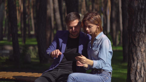 Pair in love using modern device in city Footage