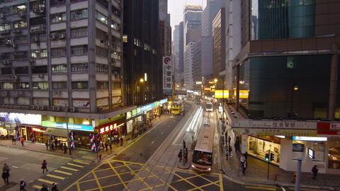 Evening traffic on city street. Hong Kong Footage
