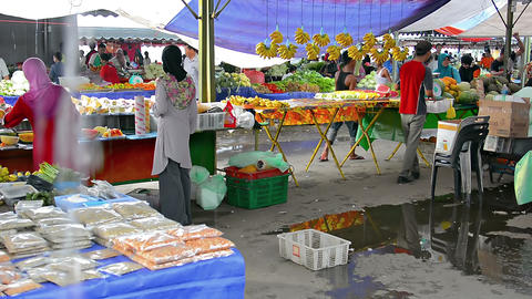 Local vendors selling fruit at the outdoor public market in Kota Kinabalu Footage