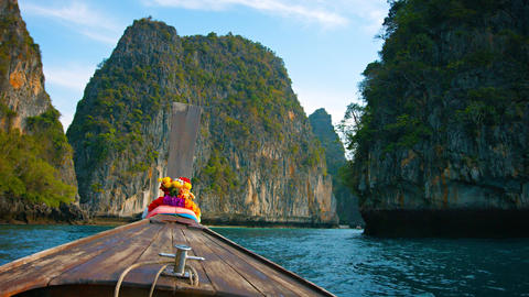 Cruising amongst Limestone Formations on a Longtail Boat in Thailand Footage