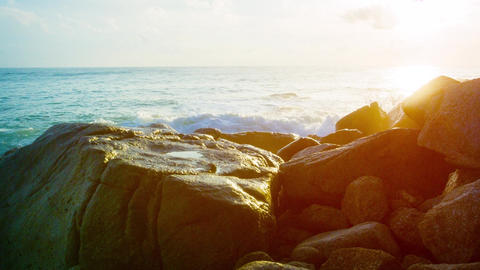 Gentle Waves Splash against Boulders in the Late Afternoon. UltraHD video Live Action