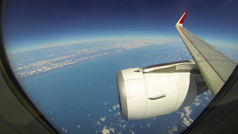 Airliner's Wing and Engine over Cloud Layers at High Altitude. UltraHD video Footage