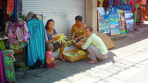 Local women weaving handicrafts on Signature Street in Ubud. UltraHD video Footage