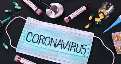 Protective medical mask with Coronavirus text and virus test objects Live Action