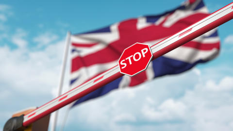 Barrier gate being closed with flag of Great Britain as a background. British Live Action