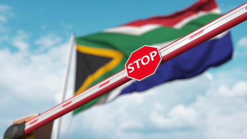 Barrier gate being closed with flag of South Africa as a background. South Live Action