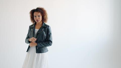 Portrait of attractive Afro-American lady posing for camera in professional Live Action
