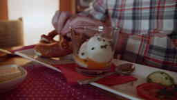 Person eating eggs in a glass at a restaurant stock footage Live Action