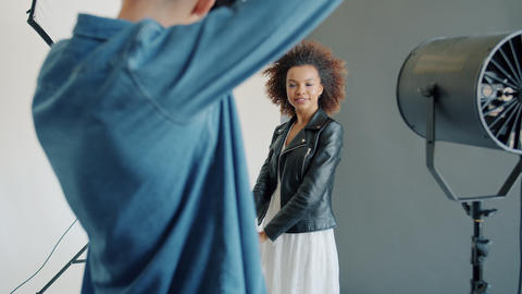 Beautiful mixed race model posing for photographer taking pictures with Live Action