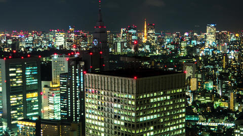Tokyo - Night aerial city view. Shinjuku 2016. 4K resolution time lapse zoom out Footage
