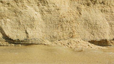 Erosion of Beach Sand by Rain Runoff Footage