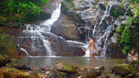 Tourist Bathing in Pool beneath Natural Waterfall. Video 3840x2160 Live Action
