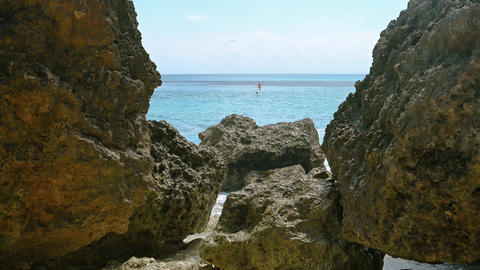 Tropical Ocean Horizon from amongst the Rocks. Video 3840x2160 Footage