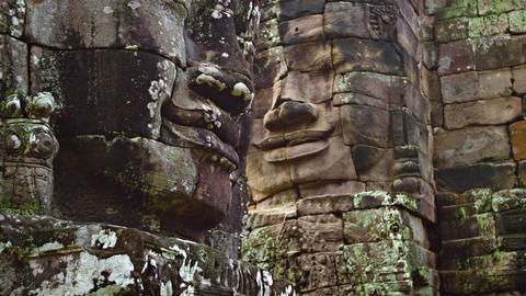 Ancient and Enormous Stone Faces at Bayon Temple in Cambodia. Video 3840x2160 Live Action