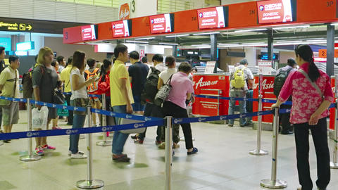 Passengers queued up to check in with Air Asia at Don Mueang Airport Footage
