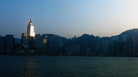 Last rays of sunshine glinting off highrise building in downtown Hong Kong Footage