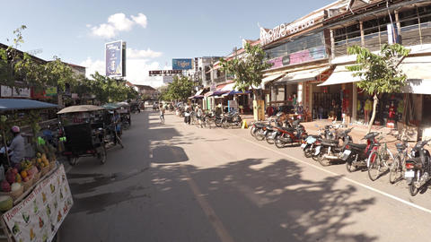 Walking along a typical commercial street in Siem Reap's tourist district Footage