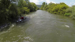Two Angles Shot: Man in kayak rowing downstream and upstream-side angle shot Footage