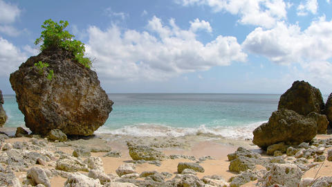 Small Waves on a Rocky Tropical Beach. with Sound. Video UltraHD Footage