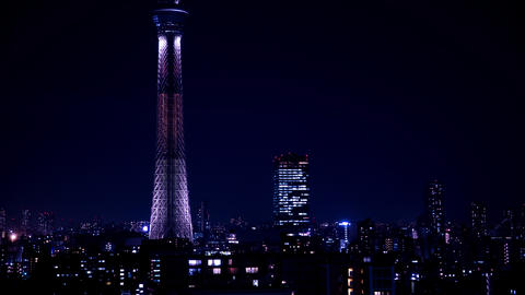 A night timelapse of Tokyo sky tree at the urban city in Tokyo middle shot tilt Live Action