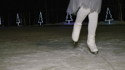 Cropped shot of girl dancing on skating rink at night time Live Action