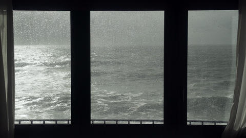 View of the stormy sea from the window. Watching the storm. Severe raging sea Live Action