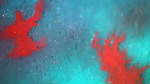 Abstract red splash mix in blue textured background. Watercolor color mix together Live Action
