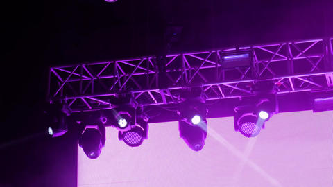 Colorful bright strobing concert lighting equipment for stage at nightclub Live Action
