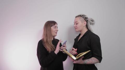 Female beautician discusses future procedures with a client Live Action
