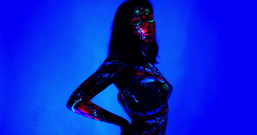 Colorful patterns on the body of a young woman, ultraviolet body art, 4k Live Action